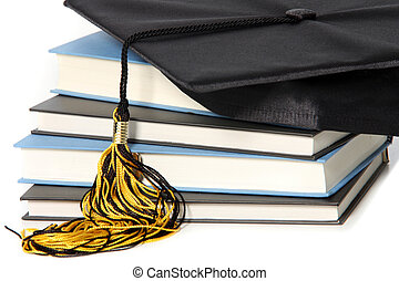 graduation cap and books on white background