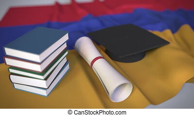 Graduation cap, books and diploma on the Armenian flag. Higher education in Armenia related conceptual 3D animation