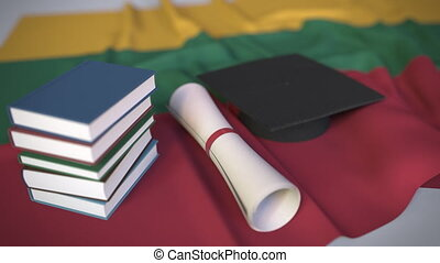 Graduation cap, books and diploma on the Lithuanian flag. Higher education in Lithuania related conceptual 3D animation