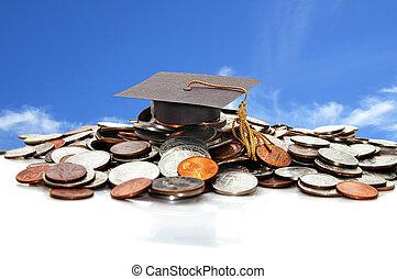 Graduation cap on a pile of coins