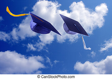 Graduation Caps  - Graduation caps throwing in the air