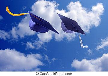 Graduation Caps  - Graduation caps throwing in the air