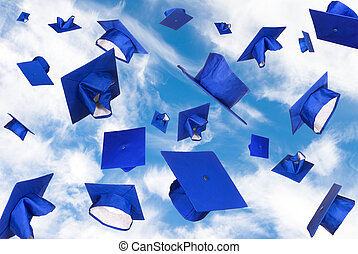 Graduation caps in flight - Graduation caps fly in the air ...