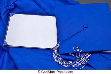 Graduation Day - Cap, gown, and blank diploma with copy...