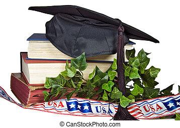 Graduation Day - Graduation cap on books with patriotic...