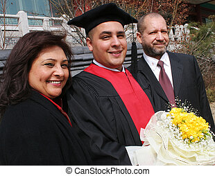 Graduation day - Happy graduate with his mother and father.