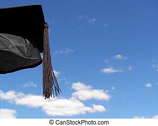 Graduation Day - Graduation cap in the summer sky.