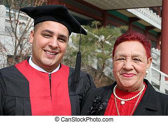 Graduation day - University graduate with his grandmother -...