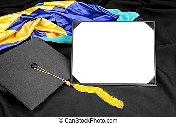 A graduation setting with cap, tassel, gown, hood and blank diploma for designers to place copy.