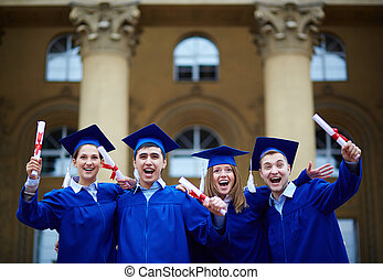 Graduation excitement - Group of smart students in...