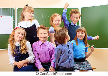 graduation - Happy schoolchildren at a classroom. Education.