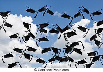 graduation hats in sky