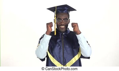 Graduation in glasses showing thumbs. White. Slow motion. Close up