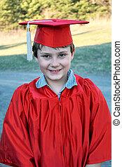 graduation kid - Cute young boy in a graduation cap and...