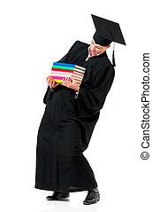 Graduation man carrying heavy books