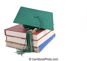 Graduation - Green graduation hat sitting on top of some...