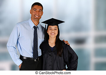 Graduation - Student graduating standing by her teacherat...