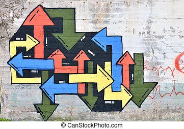 Graffiti arrows sprayed on a wall