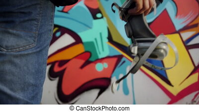 Graffiti artist holding protective mask 4k - Mid section of ...