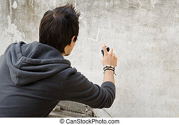 Graffiti artist holding spray can