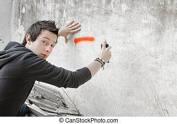 Graffiti artist surprised in action
