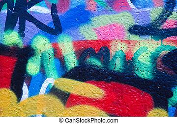 Closeup of a wall with colorful graffiti artwork