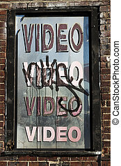 Graffiti Covered Video Window Sign - Neglected video store...
