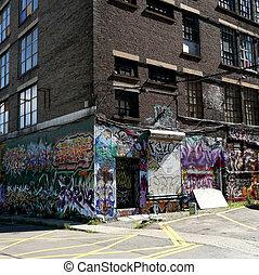 graffiti - Graffiti on a brick wall in a street