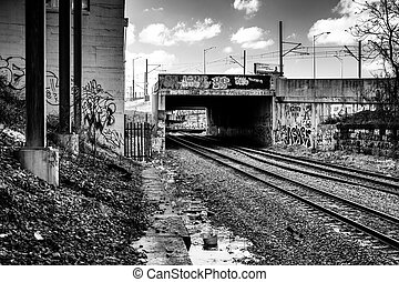 Graffiti on a bridge over railroad tracks in Baltimore, Maryland.