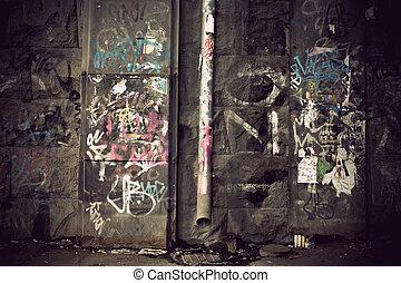 Graffiti on concrete wall - Graffiti on wall in run down...