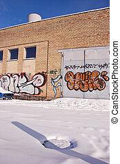 Graffiti on old white brick walls.