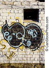 Graffiti paint on abandoned building brick wall - Graffiti...