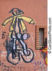 Graffiti paintings on wall. Dirty city wall. Children...