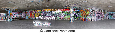 Graffiti panorama - Panoramic shot of concrete wall with...