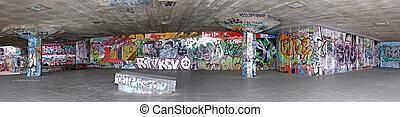 Graffiti panorama - Panoramic shot of concrete wall with...