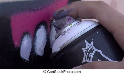 Graffiti - From an aerosol can of paint fly spray at the...