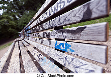 Grafitti Covered Bench - Wide angle view of a grafitti...