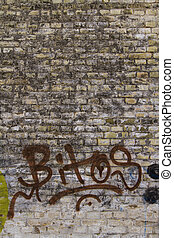 Grafitti on old brick wall