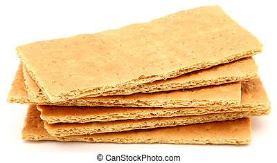 Graham Crackers - Stack of graham crackers over white.