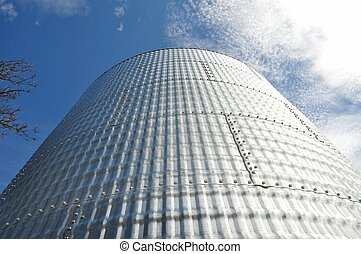 A close-up of a grain bin, looking up to the sky.