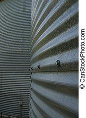 Grain Bin Texture - A close up of bolts on a grain bin in...