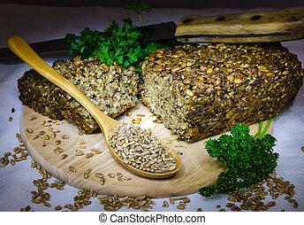 grain bread on cutting board