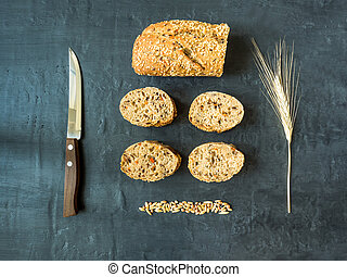 Grain bread on dark background. The view from the top.