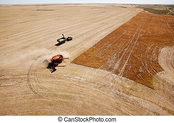 Grain Cart and Combine on Prairie Field