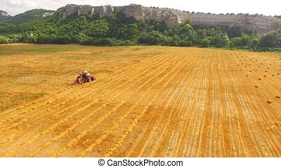 Grain Combine Harvester Working In Farm Field - This is an...