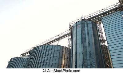 Grain elevator and agricultural storage. Steel urban...