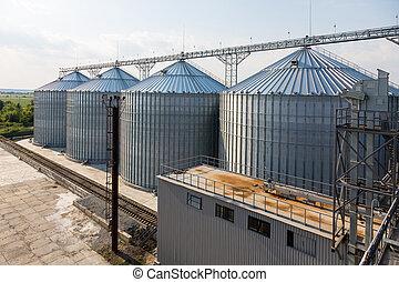 Metal grain elevator in agricultural zone