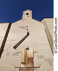 Grain elevator - Low angle of abandoned metal grain...