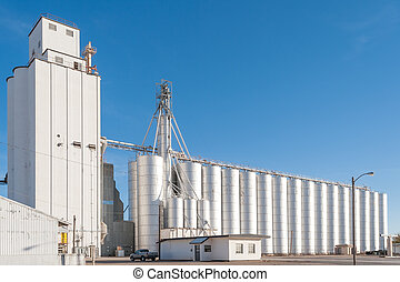 Tower and silos of big grain elevator in rural Texas, USA
