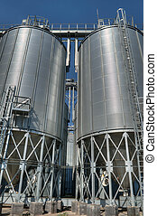 Grain Elevators - Galvanised Iron grain silos on a farm in...
